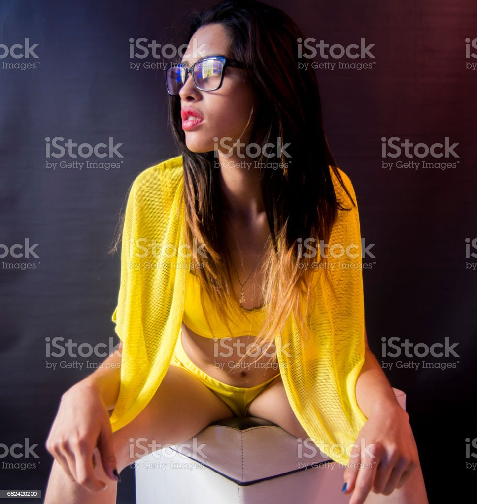 young sexy girl with glases,bikini yellow,seating front royalty-free stock photo