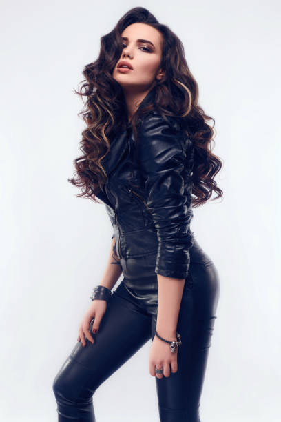 young sexy girl with long hair in leather jacket - lange jacken stock-fotos und bilder