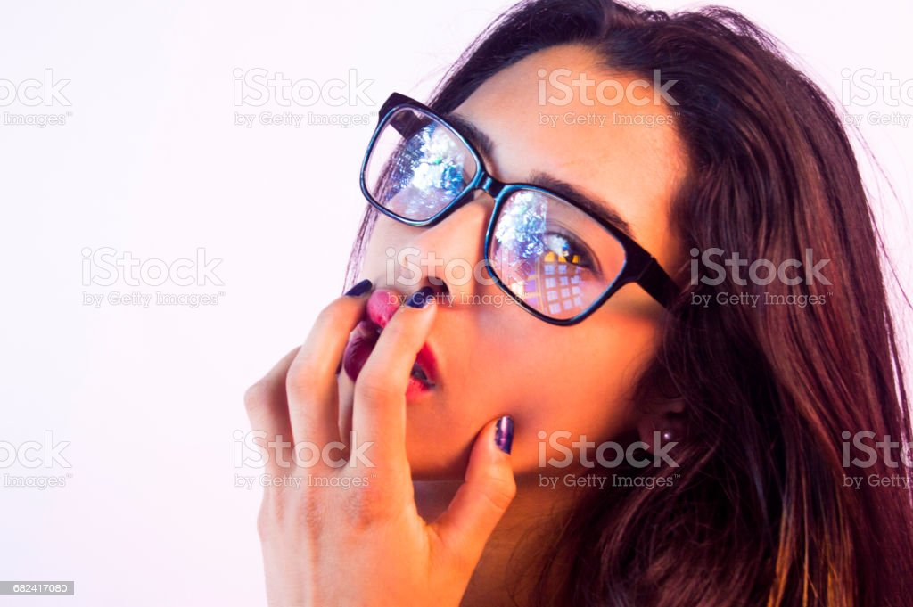 young sexy girl,reflection on glasses,fingers on the red lips royalty-free stock photo