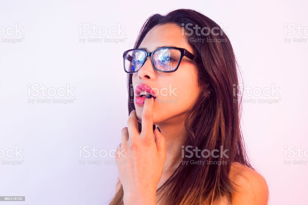 young sexy girl,reflection on glasses,one finger on the red lip royalty-free stock photo