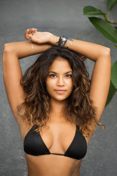 Young Sexy Gorgeous Woman in Bra Raising Arms stock photo