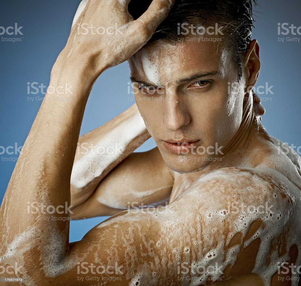 young sexy man having a shower royalty-free stock photo