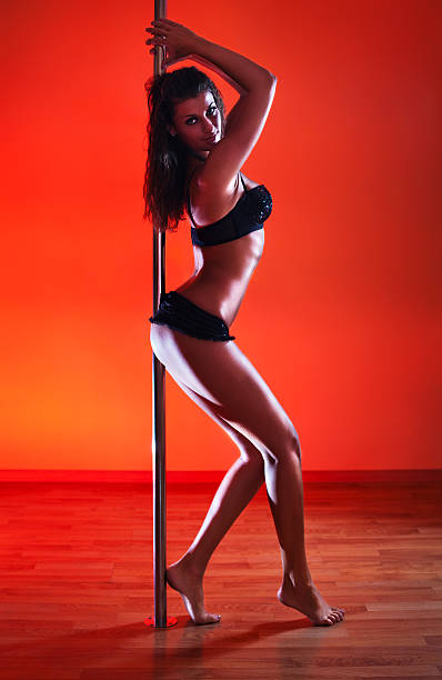 Young sexy pole dance woman stock photo