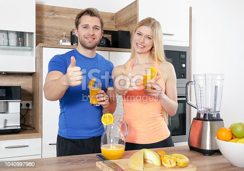 istock young sexy sporty couple is making a smoothy 1040997980