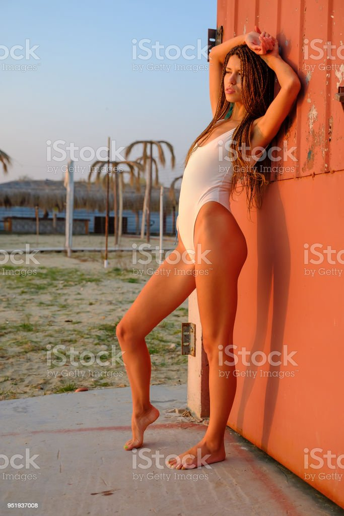 65c5a1b667 Young Sexy Tanned Woman Wearing Sexy White Bathing Suit Stock Photo ...