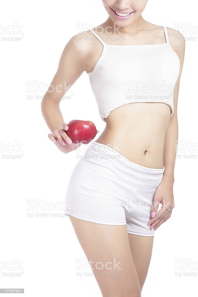 Young sexy woman body and hand holding red apple royalty-free stock photo