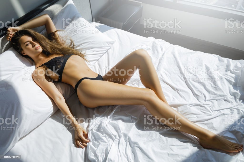 4c9505e6bd Young Sexy Woman In Black Lingerie Lying On The Bed Stock Photo ...