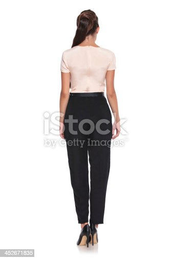 istock young sexy woman in shirt and pants 452671835