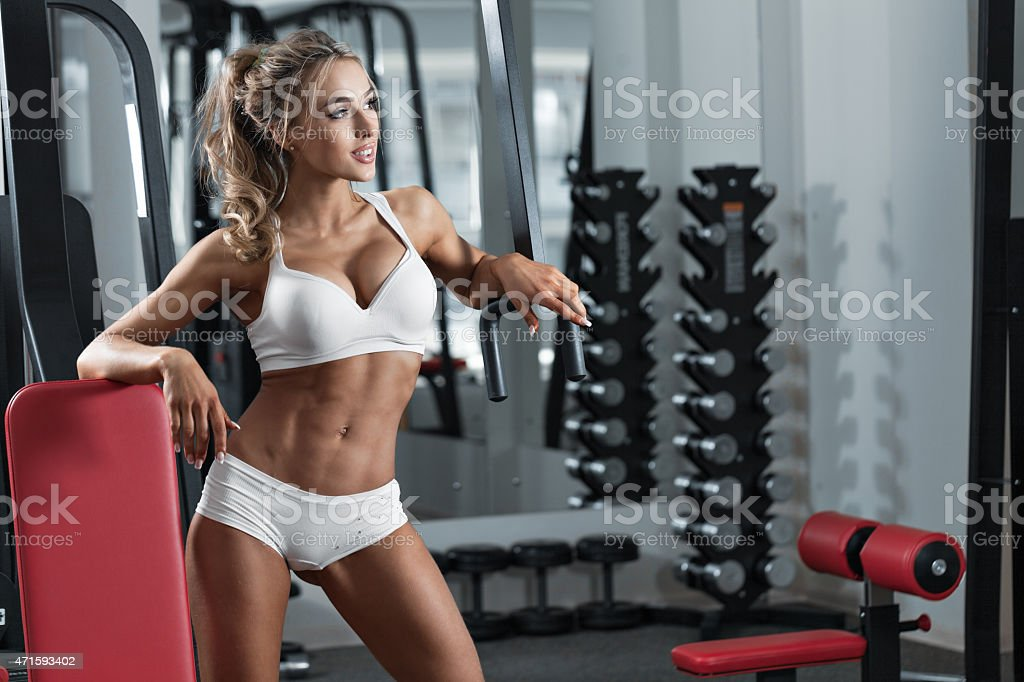 Young sexy woman in the gym stock photo