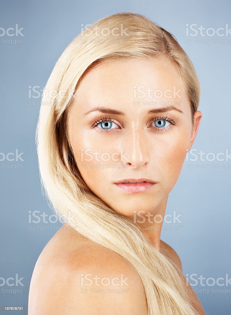 Young sexy woman isolated against colored background royalty-free stock photo