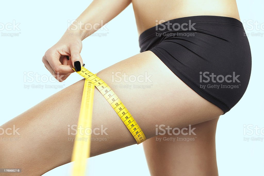 Young Sexy Woman Measuring Her Leg stock photo