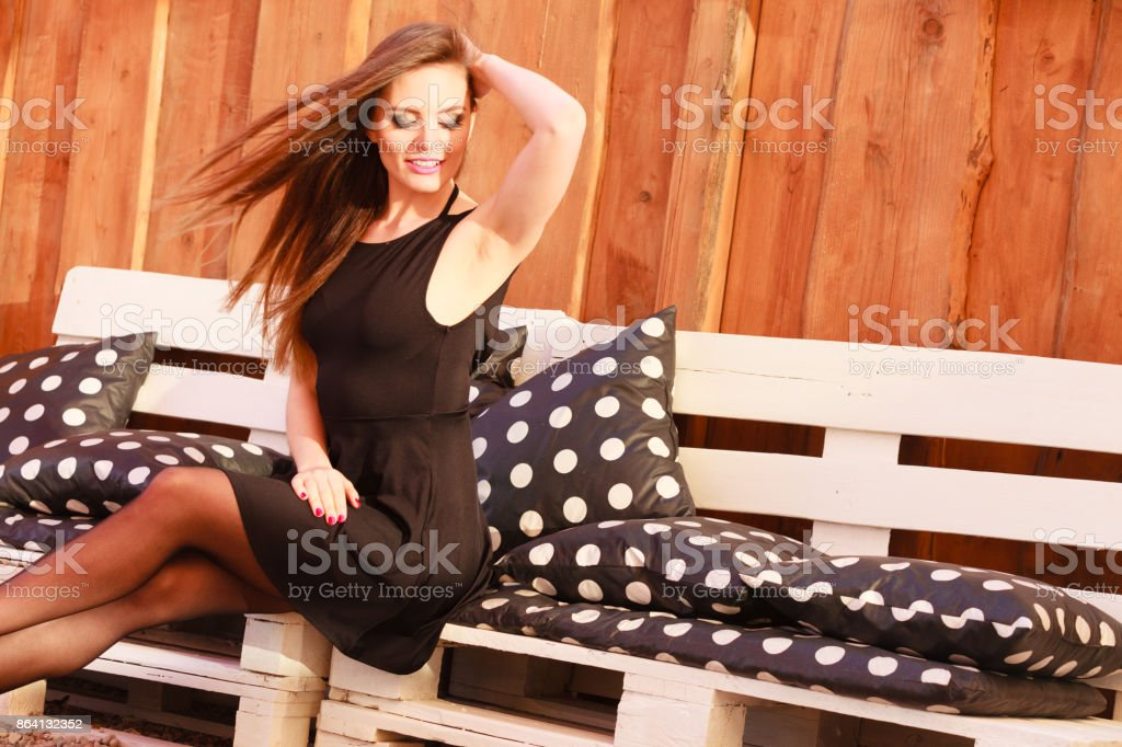 Young sexy woman posing on bench. royalty-free stock photo