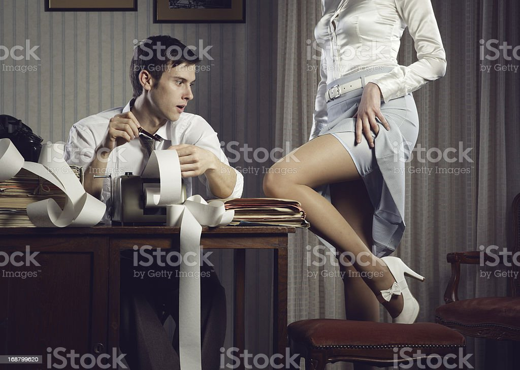 Young sexy woman shows a leg for business man stock photo