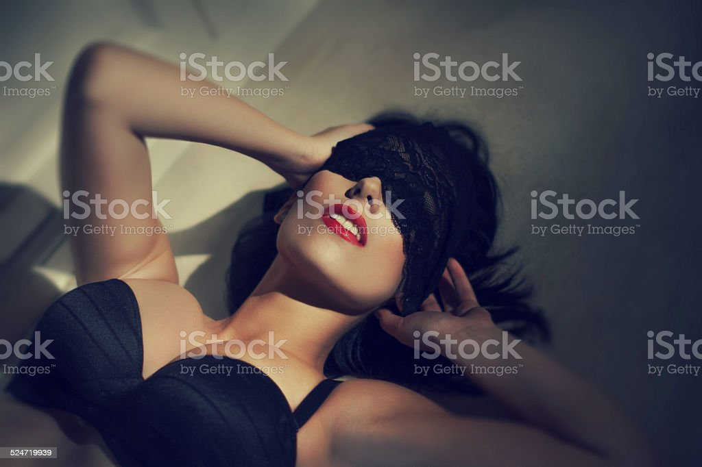 Young sexy woman with lace veil on eyes vintage style stock photo