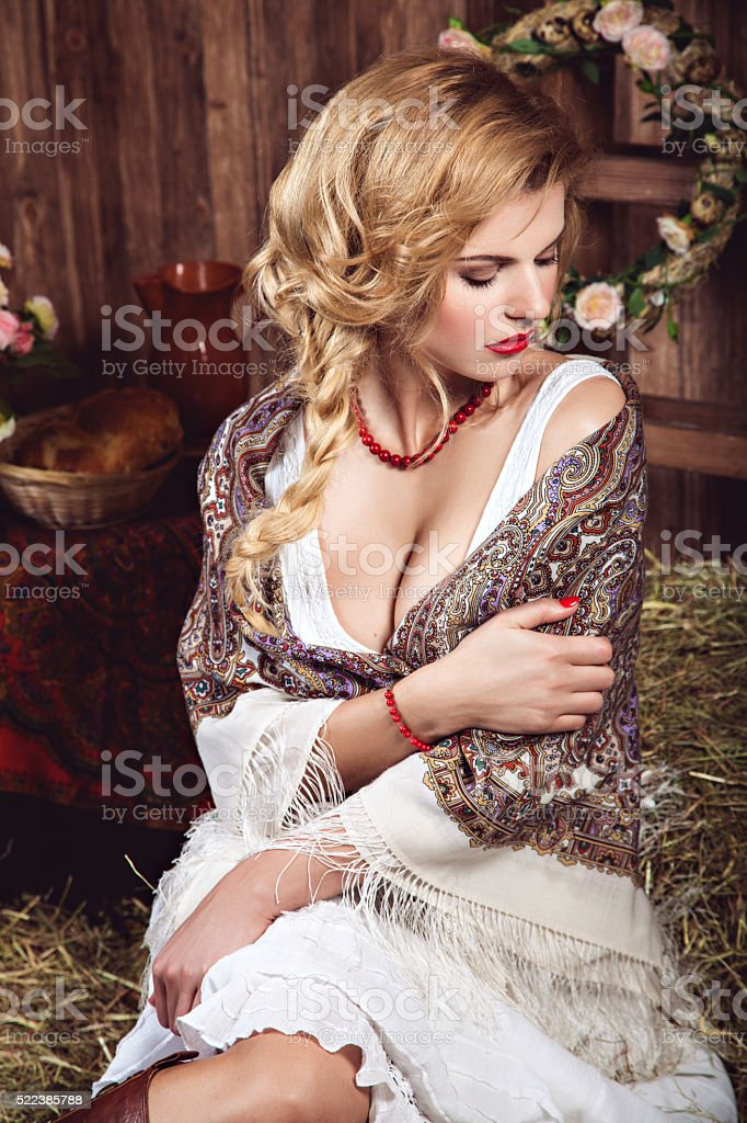 Young sexy woman with pigtail in rustic style stock photo