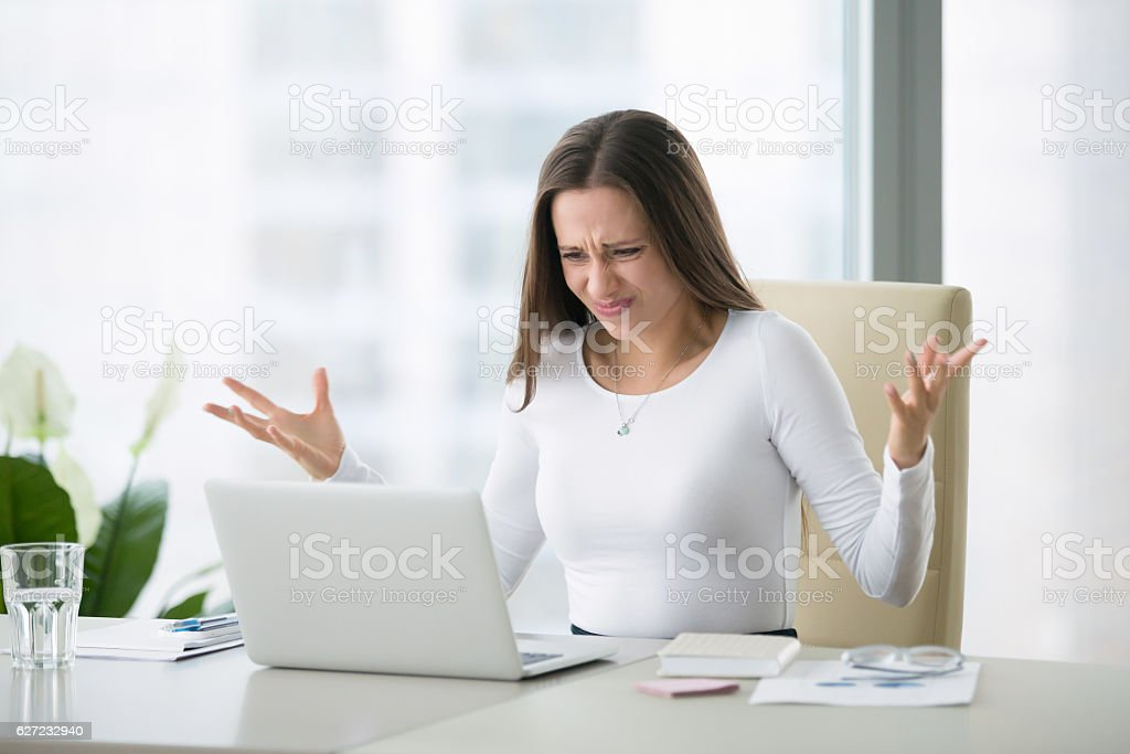 Young shocked businesswoman stock photo