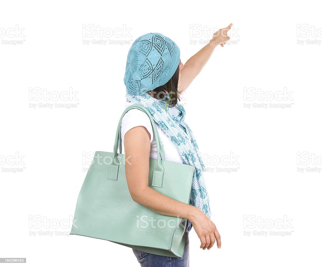 Young shopping woman pointing royalty-free stock photo