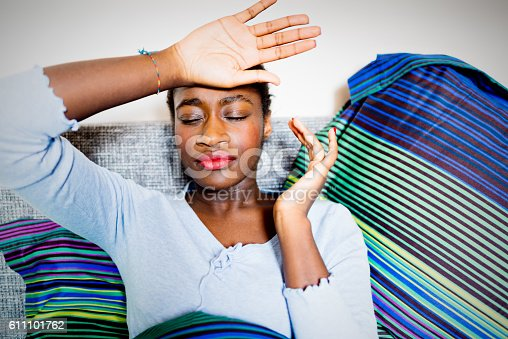 istock Young sick African woman in bed 611101762