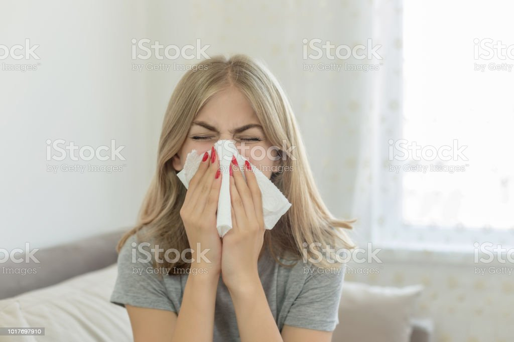 Young sick woman at home stock photo