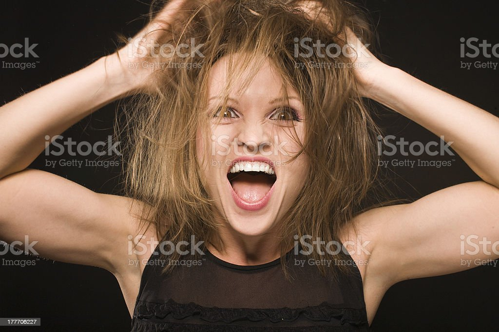 young silly crazy girl messing her hair stock photo