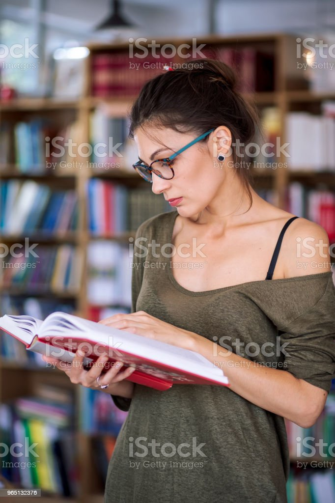 Young simpatic woman reading a book royalty-free stock photo