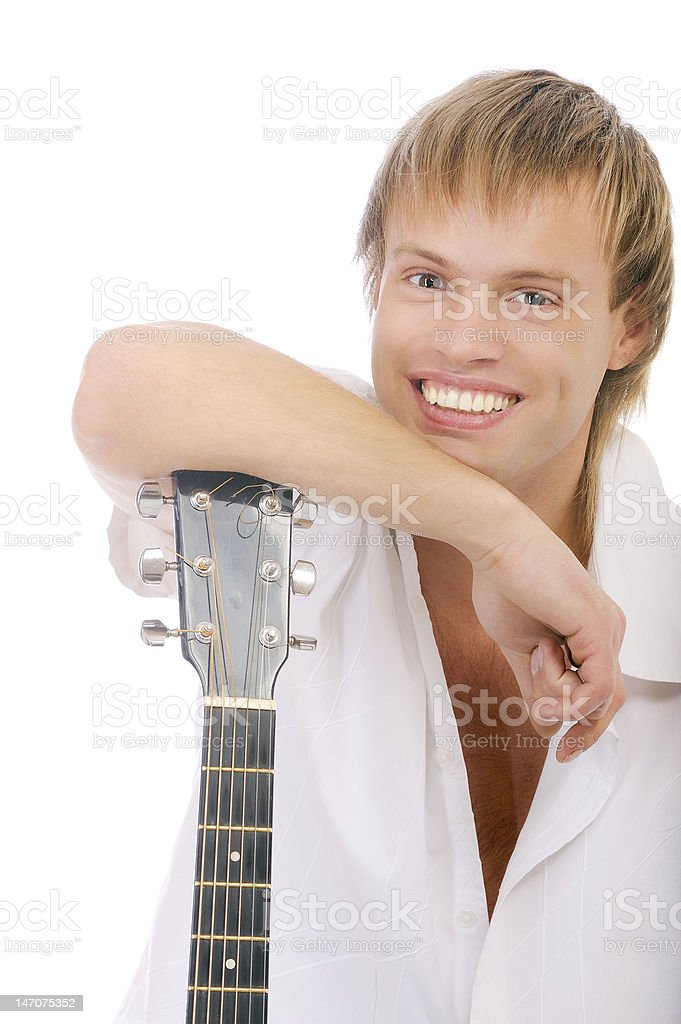 Young singer leans elbows on guitar and laughs royalty-free stock photo