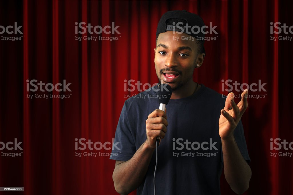 young singer vocalist on stage live show red curtain stock photo