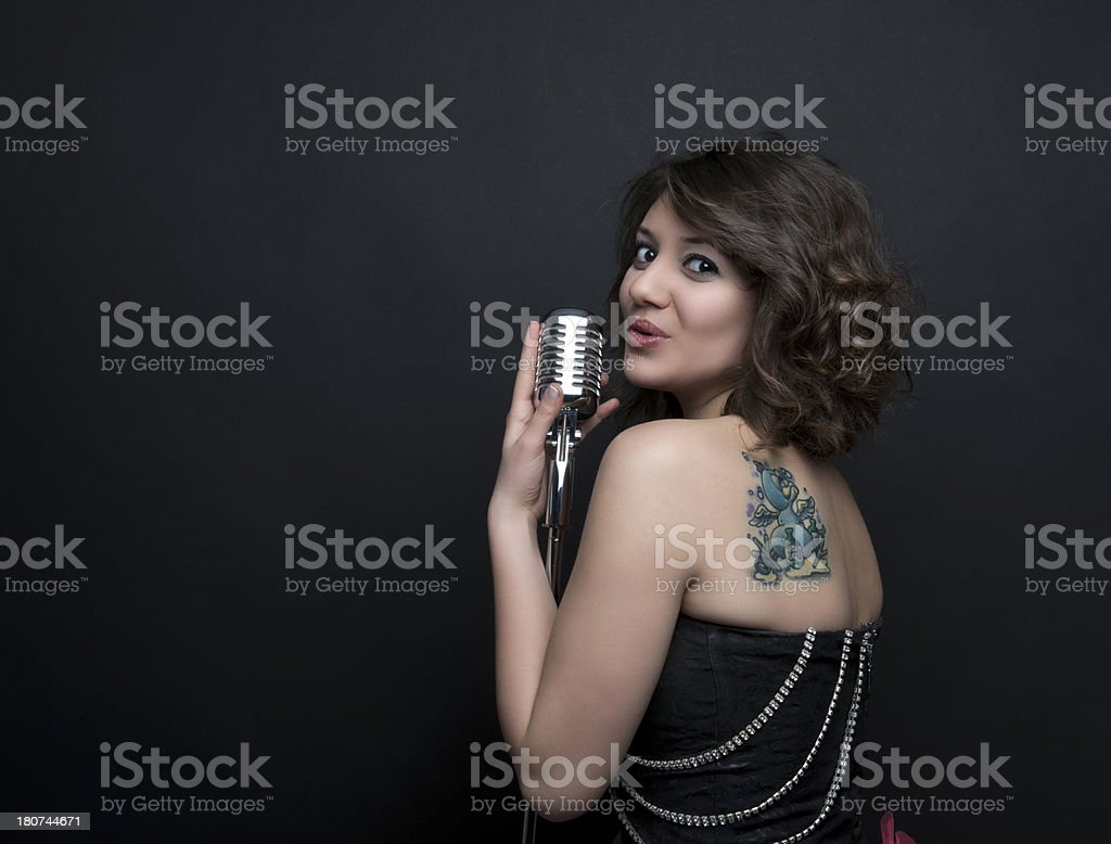 Young singer with vintage microphone stock photo