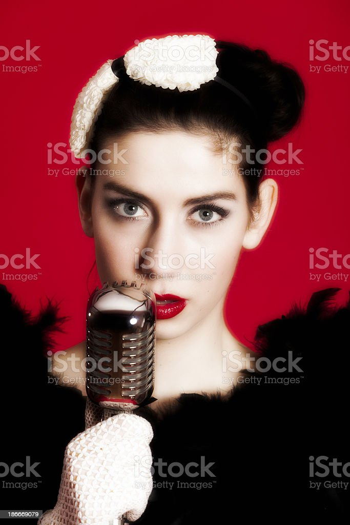Young singer with vintage microphone. stock photo