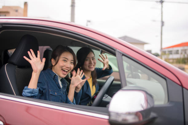 young sisters about to start - asian travel in car stock photos and pictures