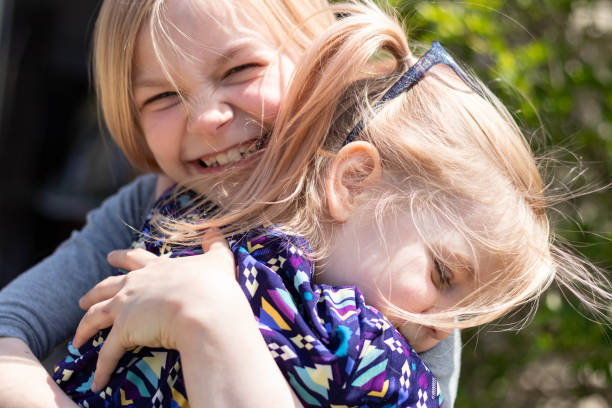 Young Sisters Hugging 3 – zdjęcie