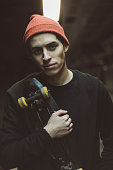 Young skateboarder, wearing a red cap, close-up portrait. Belgrade, Serbia, Europe