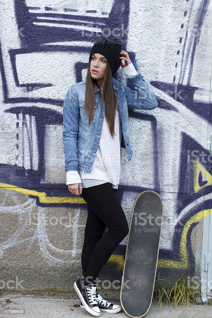 Young skateboarder girl look away royalty-free stock photo