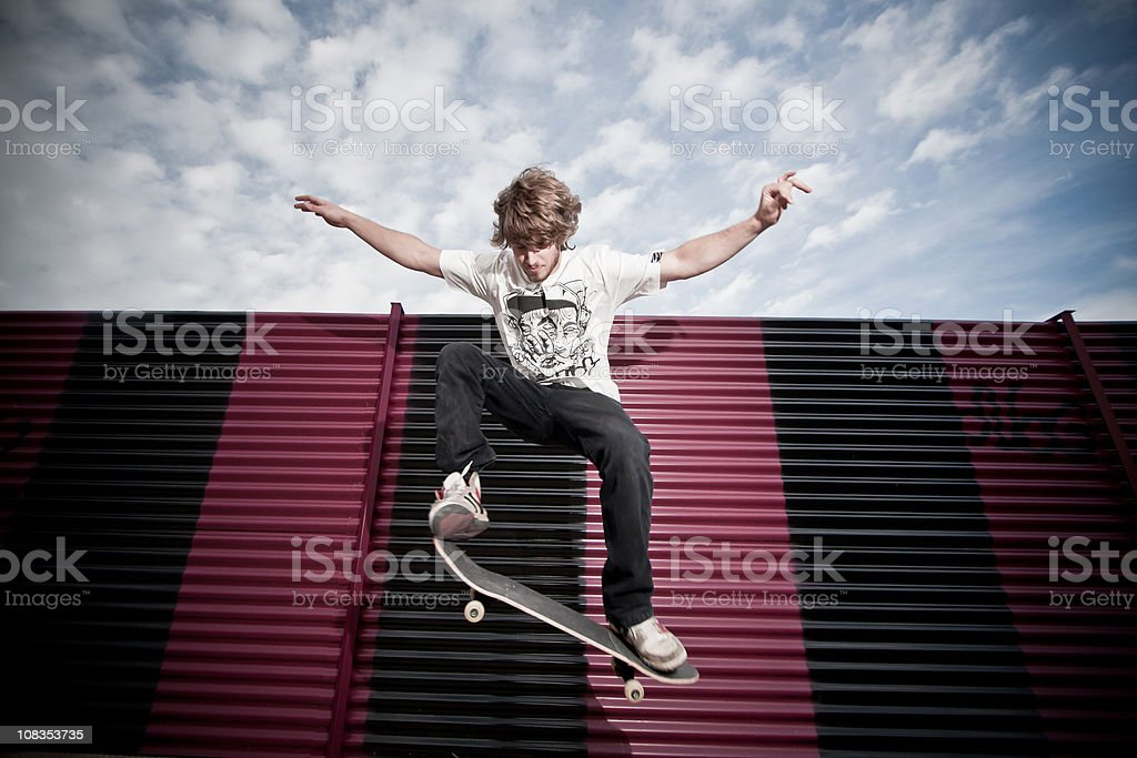 Young skateboarder jumping royalty-free stock photo