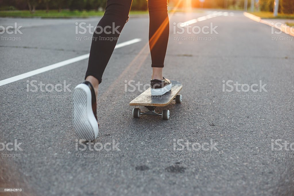 young skateboarder legs riding on skateboard in front of the Lizenzfreies stock-foto