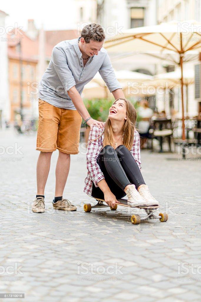 Young skateboarding couple stock photo