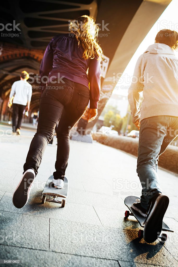 Young Skater Girls Riding Their Skateboards stock photo