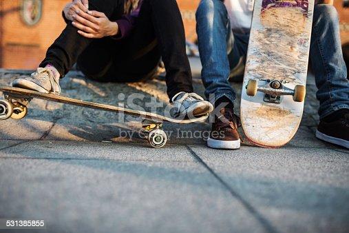 Close-up shot of skater's feet resting on skateboard