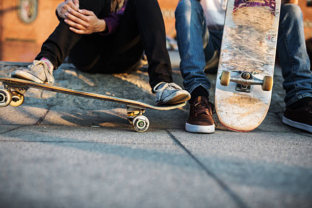 young skater relaxing - skateboarding stock pictures, royalty-free photos & images