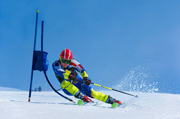 Young Skier Practicing Giant Slalom stock photo