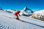 Young skier skiing at Zermatt ski resort with Matterhorn mountain in background, Valais canton, Switzerland, in winter morning. Taken by Sony a7R II, 42 Mpix.