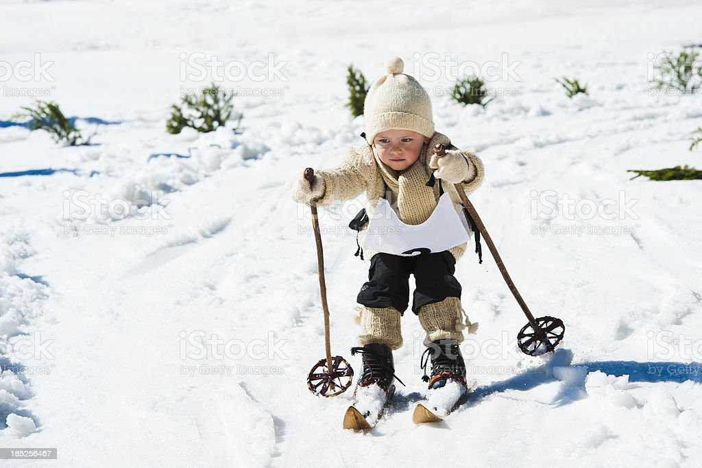 Young skier using retro ski equipment stock photo