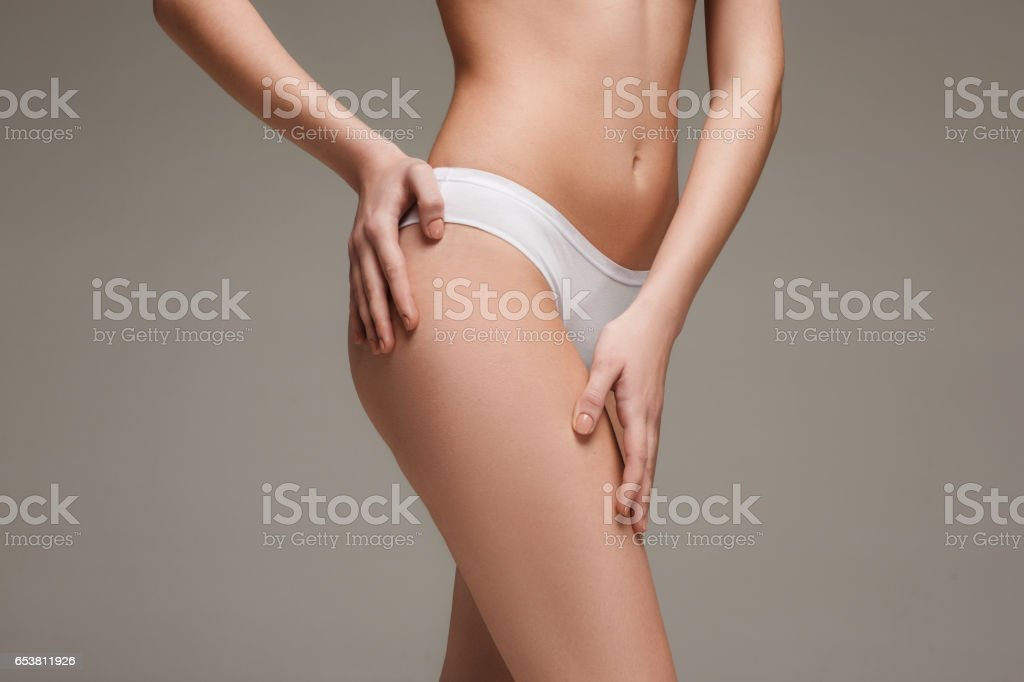 Young, slim, healthy and beautiful woman in white lingerie stock photo