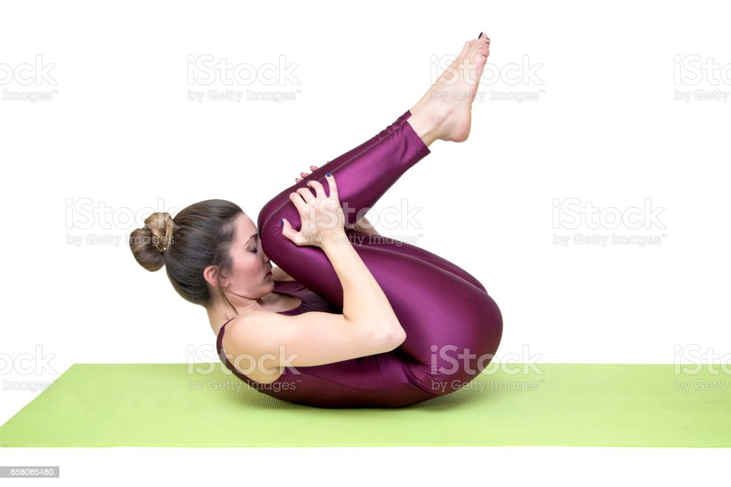 Young slim woman  practicing yoga in the studio royalty-free stock photo
