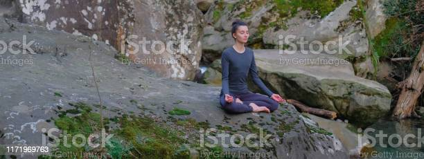Young slim woman practicing yoga outdoors on big moss rock unity with picture id1171969763?b=1&k=6&m=1171969763&s=612x612&h=7znyjtancehxggcf62fl ldnhv7lcq0eakbjkdb91zw=