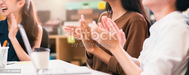 862720340 istock photo young smart asian entrepreneur  startup company with successful and confident with hand clap applause appreciation in brainstorm meeting office background close up banner image 1218196998