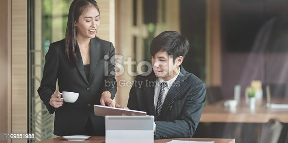 1068752548istockphoto Young smart businesswoman pointing out the idea 1169851988