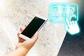 Female traveler using a smartphone to plan book trip