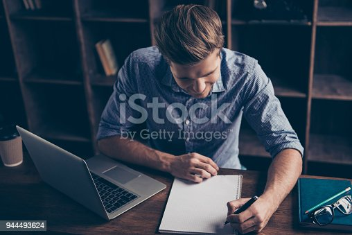 istock Young smart student doing task and making notes 944493624
