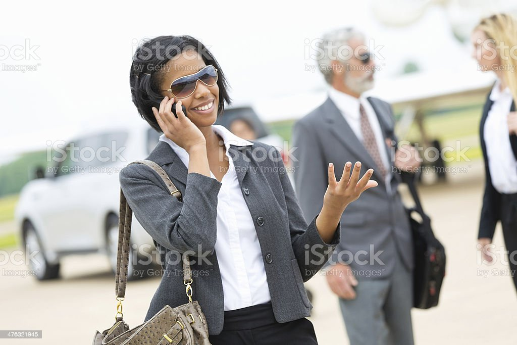 young smartly dressed woman making a phone call royalty-free stock photo